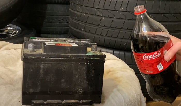 how to clean a corroded car battery with coca cola